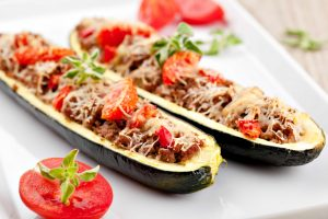 Zucchini halves stuffed with minced meat and vegetable